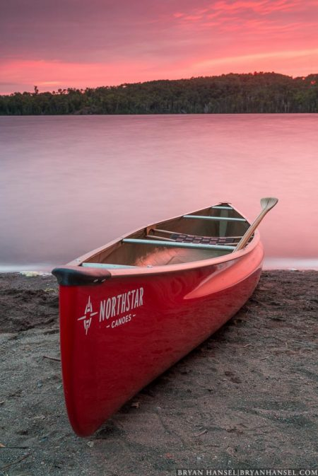 a canoe under a red sky on Mink Lake