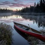 sunrise over a canoe near the BWCA