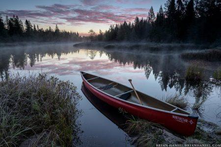 sunrise over a canoe near the BWCA