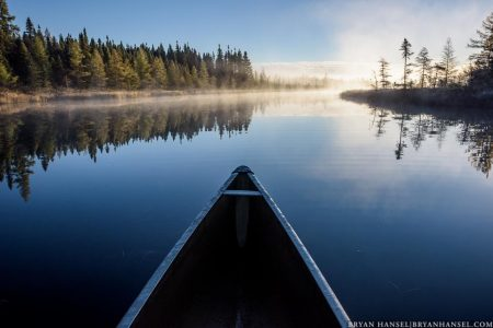 canoeing on a morning misty lake