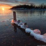 sunrise over the east bay in grand marais, mn