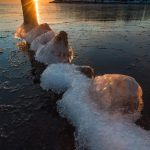 sunrise over Lake Superior and old dock pilings