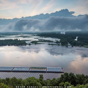 sunrise from Pike's Peak with a barge on the Mississippi River