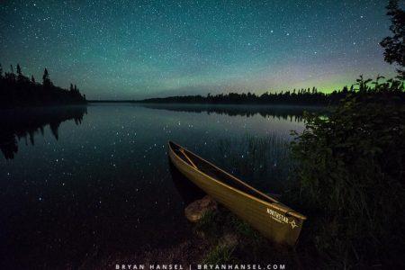 Northstar Magic canoe under the northern lights on Cascade Lake