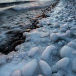sunset over an icy Lake Superior shoreline