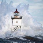 Waves crash into Grand Marais lighthouse