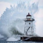 grand marais lighthouse and a massive wave