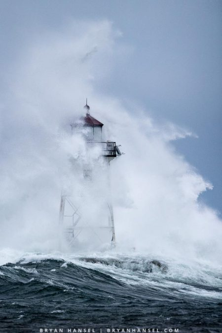 Grand Marais lighthouse getting hammered with gale force winds and waves
