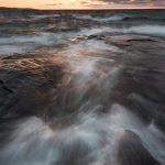waves crash on artist's point at sunrise